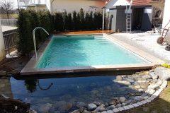 17-Fertiger-Biopool-mit-Granitumrandung-und-Gartenhaus-scaled